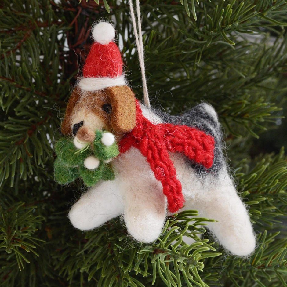 fox terrier with mistletoe tree decoration