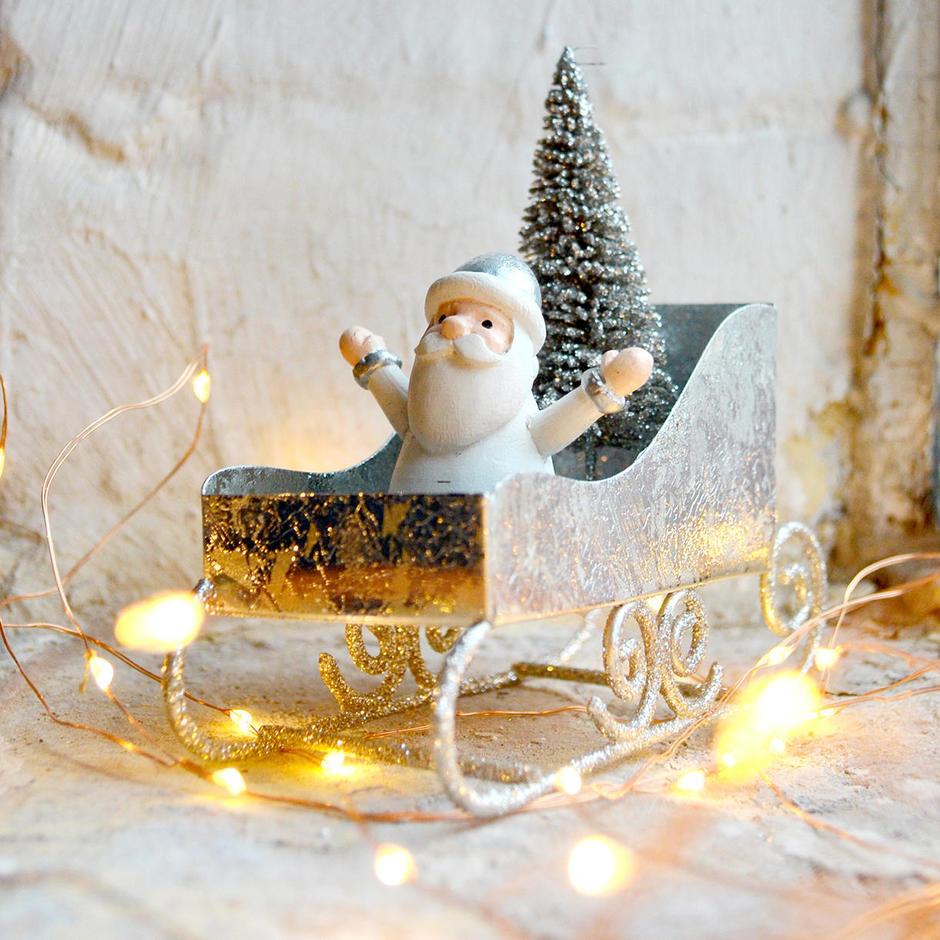 Joyriding Sled Santa
