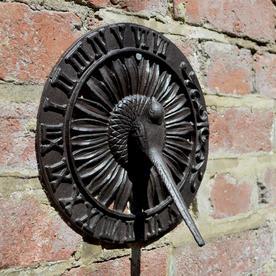 Sundial with Bird Figurine