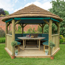 4m Hexagonal Gazebo with Thatched Roof - Furnished Green